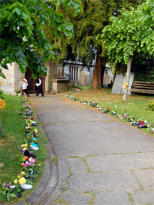 Flower filled shoes lining the path to the church