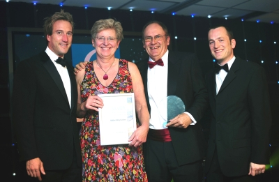 Tricia and Peter Howard accepting their Cornwall Tourism Award from Ben Fogle