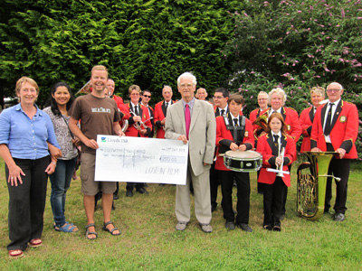 Lost In Film presenting cheque to Lostwithiel Town Band