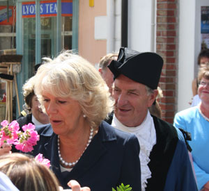 A boquet is presented to the Duchess of Cornwall