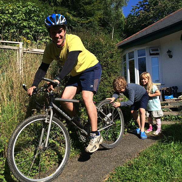 Dominic Bond with children Raffy and Lottie, ready to cycle to work as part of his general  fitness training.