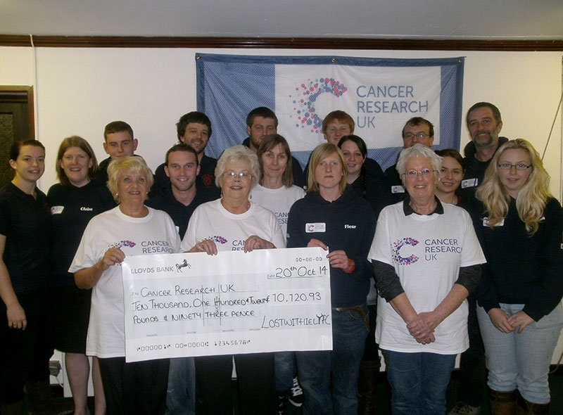 Lostwithiel YFC presenting cheque to Cancer Research